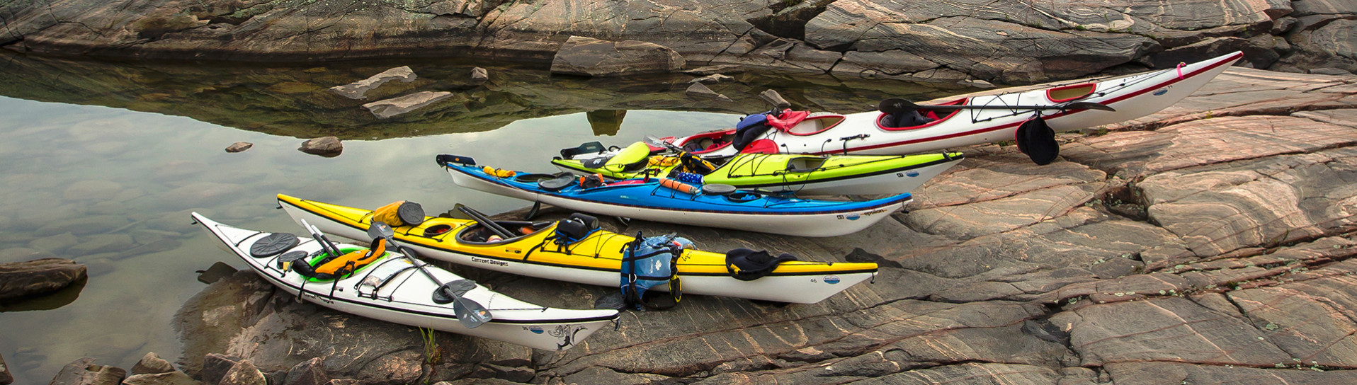 Sea kayaks on rocky shore
